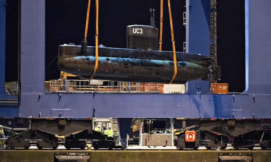 Metal monster: Madsen's UC3 Nautilus is lifted onto a block truck from the salvage ship Vina.