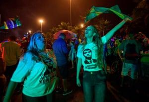 Bolsonaro supporters celebrate outside his home in Rio de Janeiro.