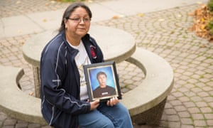 Maryanne Panacheese holds a photo of her son Paul outside of the inquest of the death of seven students who died while attending school in Thunder Bay.