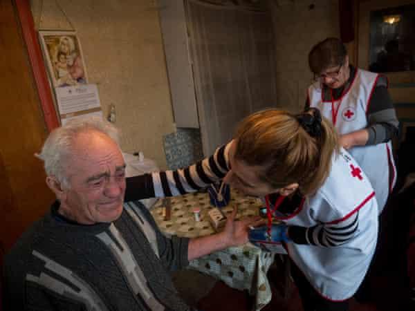 Red Cross nurses Gayane and Armine with Gevorg