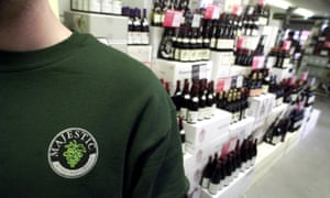 Majestic Wine bottles and staff member in logo T-shirt