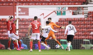 Lyle Taylor (second from left) scores for Nottingham Forest to earn a 1-1 draw against Derby