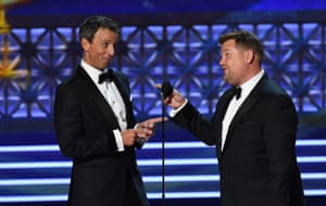 Late night TV hosts Seth Meyers (left) and James Corden appear to present the award for outstanding supporting actor in a comedy series.