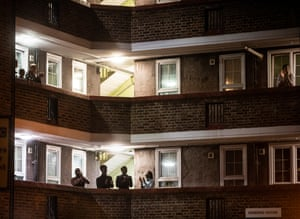 People on their balconies in Southwark, south London