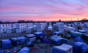 """Areas of Calais """"Jungle"""" camp cleared<br>18 Jan 2016, Calais, France --- Calais, France. 18th January 2016 -- Shipping containers have been erected to house refugees removed from the clearing zone, though they remain unpopular due to restriction they impose and . Many have simply moved their tents further into the camp. -- The process of cleaning 100m-wide """"clearing zones"""" flanking the motorway that runs along the Calais' informal refugee camp began Monday (18th Jan), following efforts to relocate an estimated 2,000 migrants who had been living there. --- Image by © Maximilian Clarke/Demotix/Corbis"""