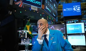 A NYSE trader looks worried as the US-Iran crisis pushes up oil prices.