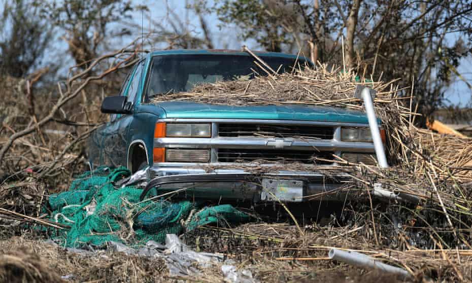 Debris covers a car in Cameron, Louisiana