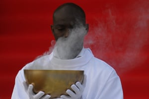 A priest carries incense during mass at the World Meeting of Families Pastoral Congress.