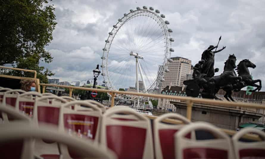 A near-empty top deck on a London open-top tour as it passes the London Eye