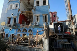 A man inspects the damage in a residential area