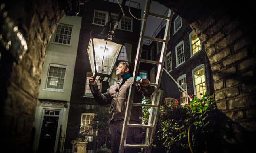 Garry Usher checks a gas lamp in Pickering Place, Mayfair