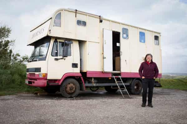 Jess, photographed in front of her home, took to the road after living for a while in camps in Ireland.