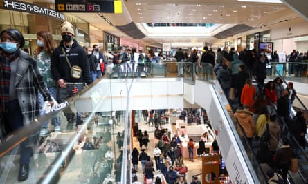 People walk through the Westfield Stratford City shopping centre.