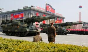 Missiles are driven through Kim Il-sung square on Saturday.