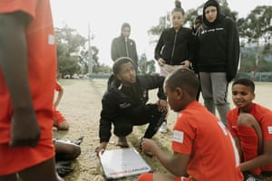 Abdurahman gives the children of the Fitzroy Lions soccer club, some guidance.
