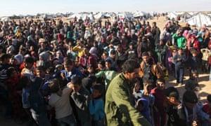 Syrian refugees at a Jordan border town