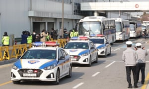 Buses carrying South Korean evacuees from the coronavirus-hit Chinese city of Wuhan leave Gimpo International Airport in Seoul on Friday.