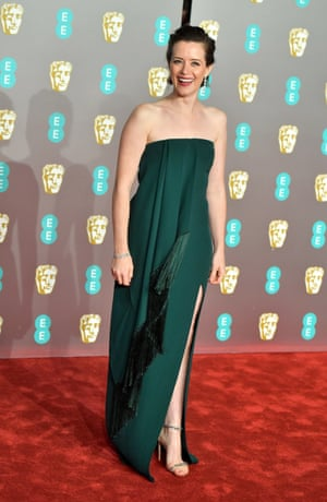 Regal … Claire Foy in a simple but stunning green Oscar de la Renta column gown with black fringed trim, and Jimmy Choo shoes