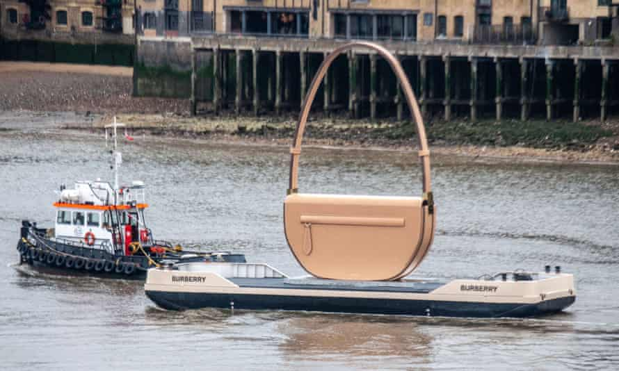 A giant Burberry handbag is towed into London on the River Thames.