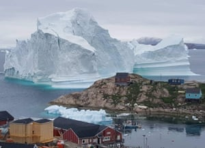A giant iceberg has prompted a partial evacuation of an Innaarsuit settlement in Greenland.