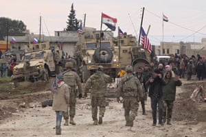 Russian and Syrian troops surround the stuck US military convoy. At least one Syrian was killed and another injured in the confused incident.