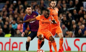 Tanguy Ndombele (centre) tangles with Lionel Messi in the Champions League last 16 in February 2019.