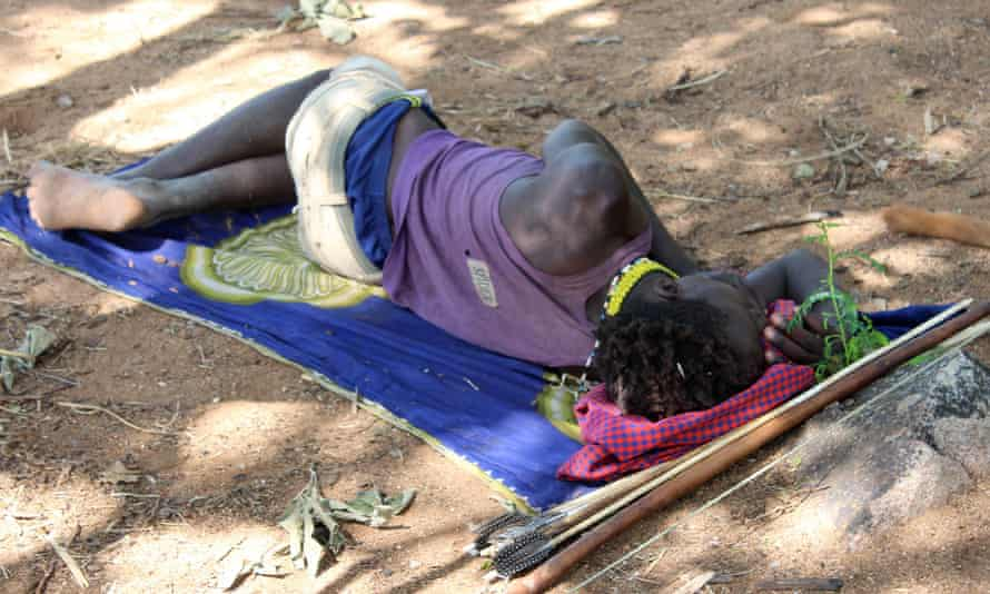 A Hadza man sleeps on an antelope skin in northern Tanzania.