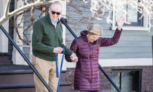 Warren with husband Bruce Mann, leaving their home before Warren announced that she is dropping out of the presidential race.
