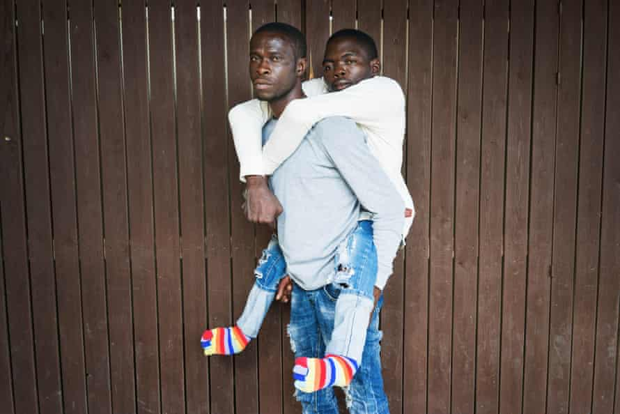 Migrants rescued by Red Cross durring crossing between Libya and Italy. Mineo, Sicily. ITALY Yusuf Oyalechuah 24years old from Nigeria and his friend Monday Payos 36 years old also from Nigeria.