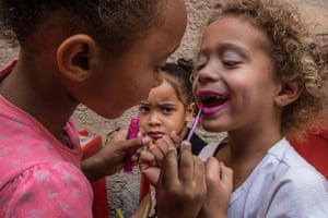 Girls play with lipstick and make-up
