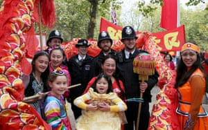 Supporters of China's President Xi Jinping pose for a picture with police officers as they wait on the Mall.