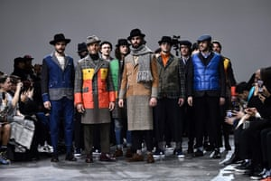 Models present clothes by Junya Watanabe Man on the catwalk in Paris, France