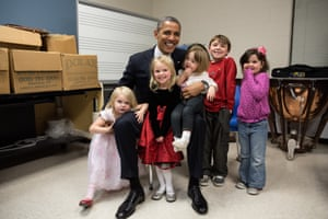 16 December: 'Two days after the shootings at Newtown, the president traveled to Connecticut to meet with the victims' families. The president spent hours greeting family members. Difficult as that was for everyone, the one moment that helped sooth the pain was when he posed for a photo with the siblings and cousins of Emilie Parker, one of the 20 children who died that day in Newtown. I see both sadness and hope in this photograph, and I know after a lot of tears that day, it meant so much to the president that everyone was able to smile for a moment in this family photo.'