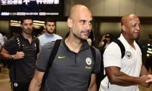 Manchester City manager Pep Guardiola arrives in Beijing