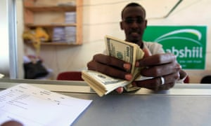 A worker counts US dollars at a money transfer office in Mogadishu, Somalia. The country has since been locked out of the remittance system.