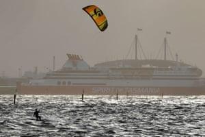 Melbourne, AustraliaA kitesurfer sails in strong winds on Port Phillip Bay