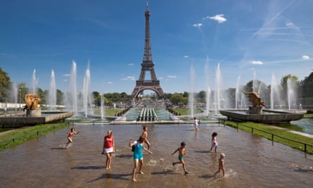 Splashing in fountains in Paris's Trocadero Gardens, across the river from the Eiffel Tower.