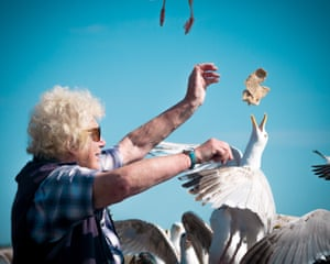 By Katy Bridgestock, winner. The Bird Lady in Pembrokeshire, Wales, feeds the local birds every day in the same spot. I love birds, and to observe the relationship she has built with these feathery friends is a fantastic experience.