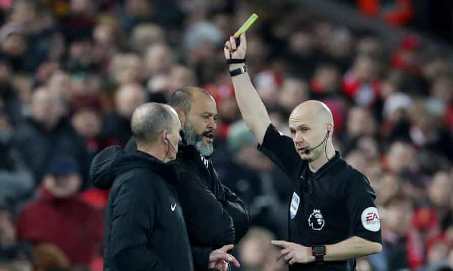 Nuno Espírito Santo (centre) is booked by Anthony Taylor after offering his opinion over a VAR decision.