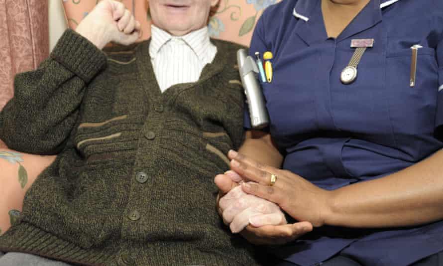 Elderly gentleman and care worker