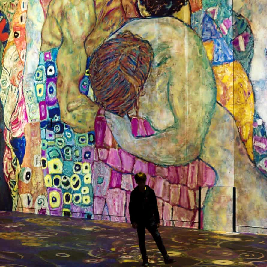 Visitor looks at a huge digital projection of Klimt's Death and Life.