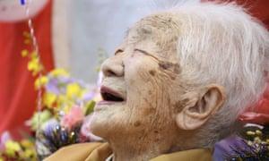 Kane Tanaka, born in 1903, smiles as a nursing home celebrates three days after her 117th birthday in Fukuoka, Japan