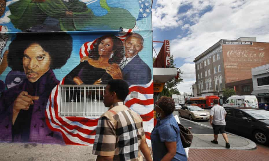 People visit the new mural at Ben's Chili Bowl in Washington.