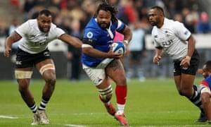 Mathieu Bastareaud runs between Fijian defenders at Stade de France in Paris last November.