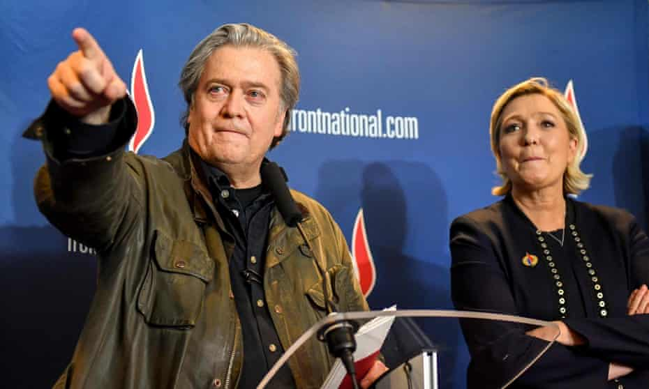 Steve Bannon speaks at a Front National gathering in Lille with its president Marine Le Pen at his side.
