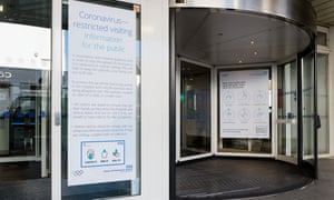 Coronavirus information posters at the entrance of the Chelsea and Westminster hospital in London.