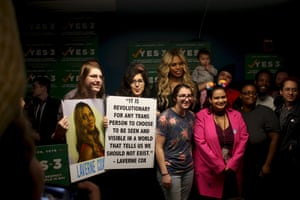 Actor Laverne Cox poses with supporters of a 2016 Massachusetts law that protects transgender people from discrimination.