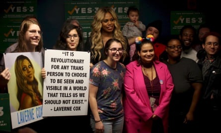 Transgender actor Laverne Cox poses with supporters of the Yes on 3 campaign.