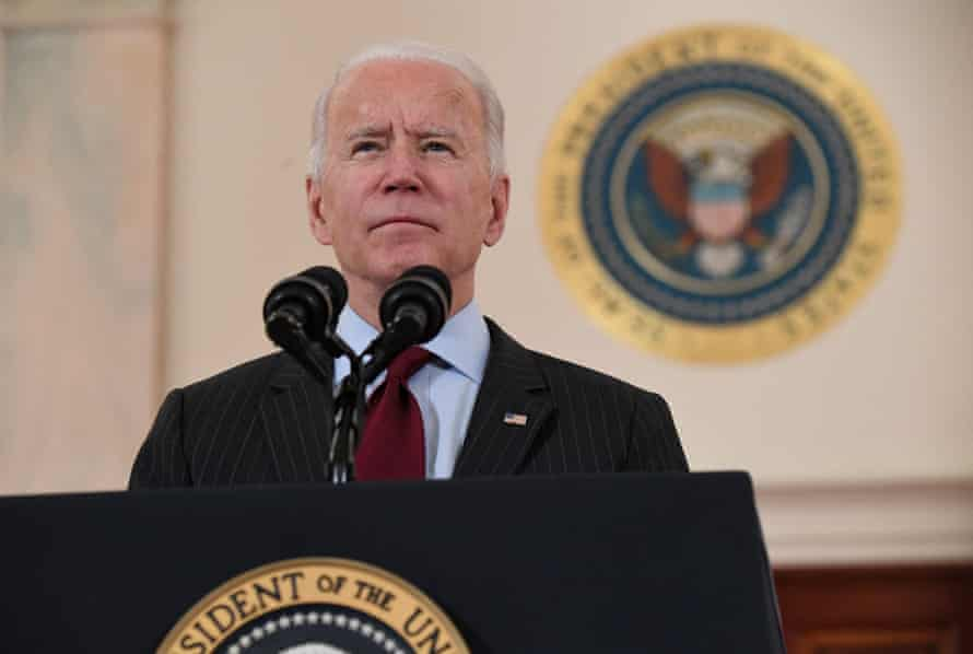 Joe Biden speaks at the Cross Hall of the White House in February about lives lost to Covid after the death toll passed 500,000.