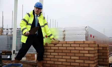 Boris Johnson lays a brick during a visit to a Barratt Homes development in Bedford, last November. The prime minister has backed plans to allow buildings to be repurposed without full planning permission.